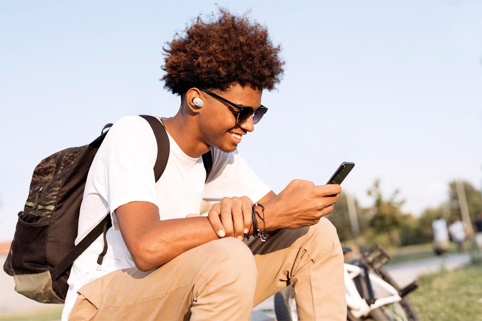 JBL TUNE 120 in-ear headphones, lifestyle